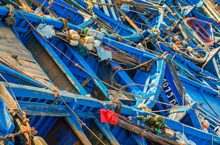 array: Beautiful array of blue boats in Essaouira port, Morocco Stock Photo