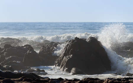 large formation: Beautiful beach landscape with big red rocks