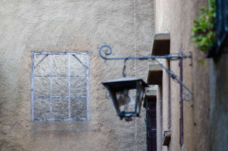 without window: Wooden window frame without glasses on street of El Jadida, Morocco