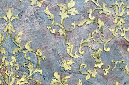 Seamless golden pattern on fabric as background. Imagens