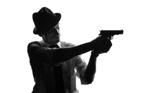 private detective: Silhouette of a private detective with two guns in both hands