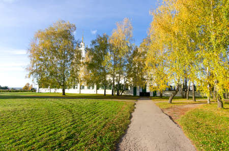 esenin: Beautiful autumn road in the Konstantinovo village with Russian church from 18th century and golden trees at background. The place where Esenin russian poet lived - most beautiful place in Rybninskiy Region - Russia, Europe