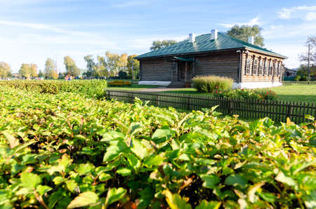 A wooden old brown school in Konstantinovo village with green at foreground from 18th century. The place where Esenin russian poet lived - most beautiful place in Rybninskiy Region - Russia, Europe