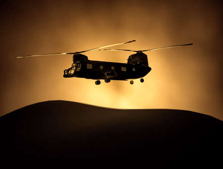 Silhouette of transport helicopter, soldiers rescue copter operations on sunset sky background. Flying in smog. 3D illustration 版權商用圖片