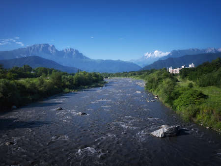 Mountain river landscape. River valley in mountains. Mountain wild river flow.