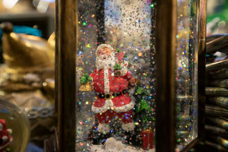 Santa Claus with snowflakes. Toy Christmas present. New Years atmosphere of celebration and fun Stock fotó