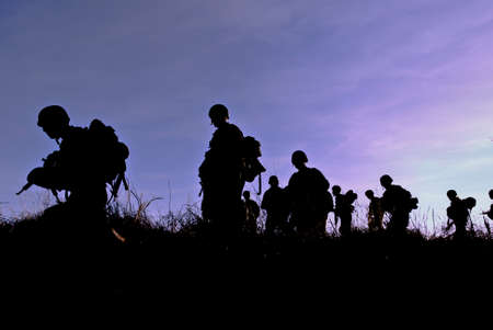 patrolling: Army soldiers patrolling during sunset