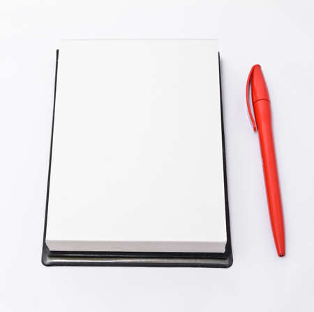 shorthand: Open notepad and a red pen isolated on white background Stock Photo