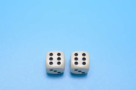 double the chances: two dice double six on a blue background. Free space for text. Game concept. Stock Photo