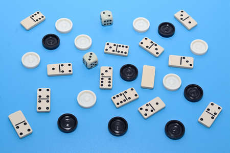 checkers: dominoes and checkers on blue background abstract