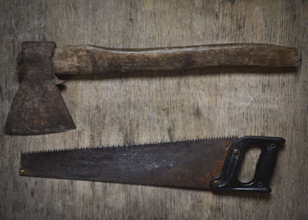 old tools: Old tools ax, saw, old tools on a wooden floor. Stock Photo