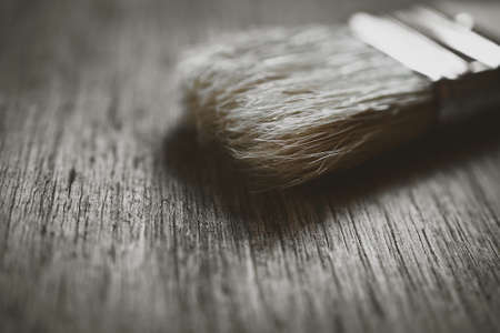brush to paint on wooden background close-up
