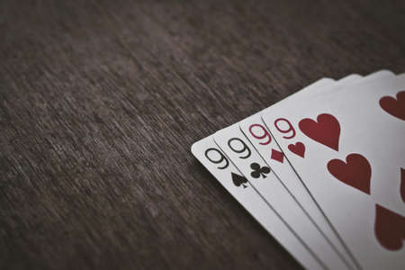 nines: playing cards four nines Stock Photo