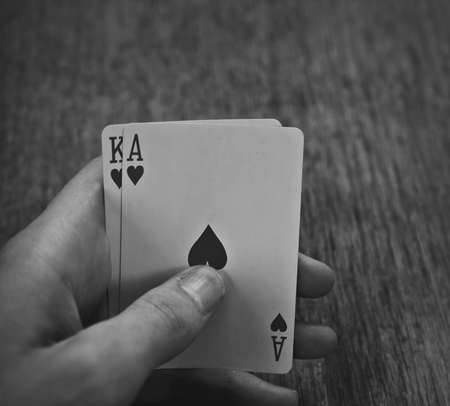 black jack: playing cards ace and a king in his hand, winning combination in Black Jack