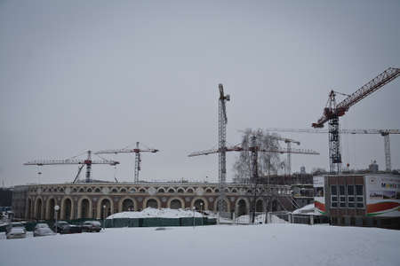 MINSK, BELARUS - January 11, 2017. Dynamo Stadium in Minsk, Belarus main sports arena. It is also the main arena football team of Belarus. reconstruction of cranes working at the site.