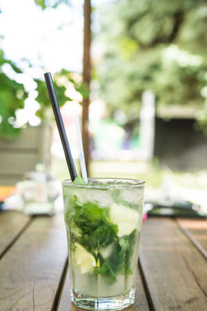Mojito on a wooden table