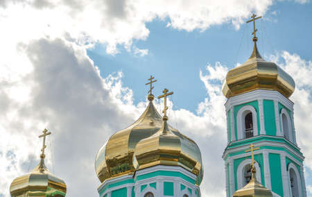 The Golden Church Dome of the Orthodox Church over sky with clouds close up Stock Photo