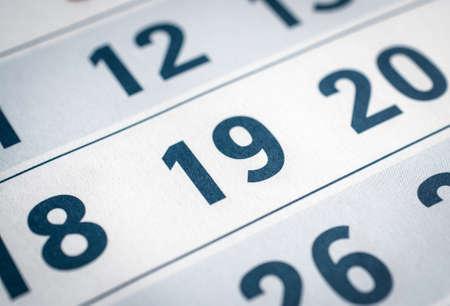 calendar close up. nineteenth and twentieth in focus