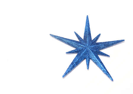blue christmas star on a white background with copyspace
