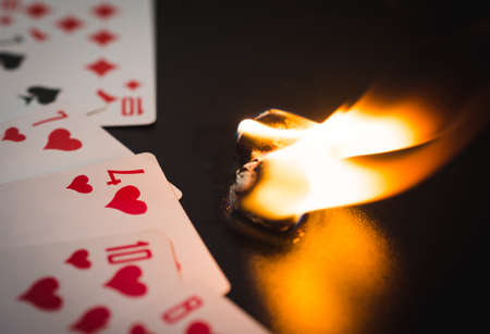 burning dice with playing cards abstract