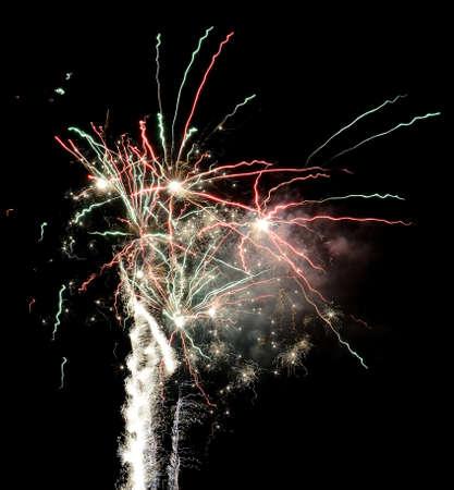 Gorgeous multi-colored fireworks display on dark background Banco de Imagens