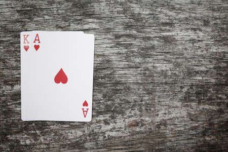 ace and king playing cards on a wooden table with copyspace Imagens