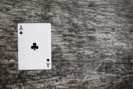 ace of clubs playing card on wooden table Stok Fotoğraf