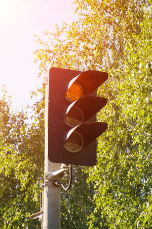 Traffic light shows red signal, railroad sign