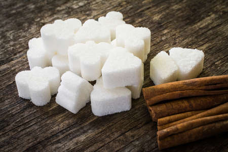 sugar cubes and cinnamon sticks close up shot 写真素材
