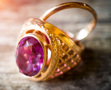 old gold ring with pink stone close up