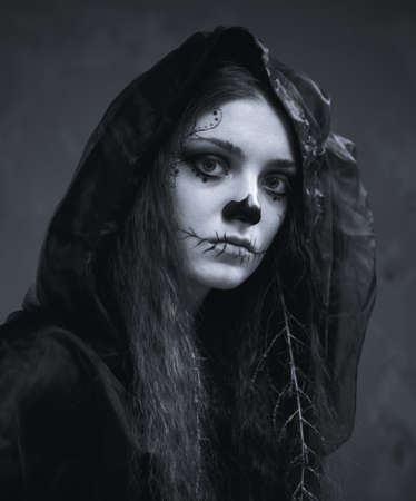 portrait of a beautiful girl halloween witch