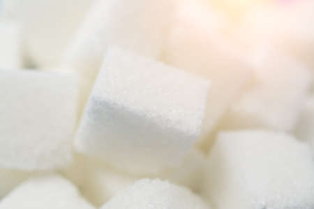 granulated sugar cubes background close up shot