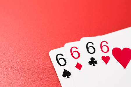 four six playing cards on a red background