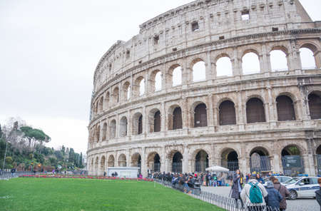 Rome, Italy - February 23, 2019: Numerous tourists in old and historic Colosseum in central Rome, Italy, world famous turist landmarks