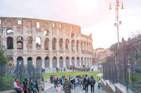 Rome, Italy - February 23, 2019: Rome cityscape colosseum view with tourist on sidewalk Editorial