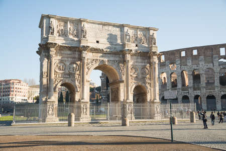 Rome, Italy - February 23, 2019: Arch of Constantine, ancient construction of emperor victory over Maxentius in 312AD, Famous Italian landmarks.