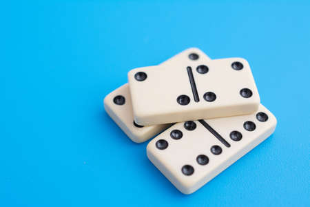 Playing dominoes on a blue background sign abstract Stock Photo
