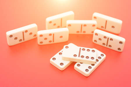 Dominoes on red table isolated, symbol abstract Stock Photo