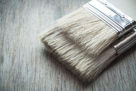 Paint brush on wooden table close up shot Standard-Bild - 119027422