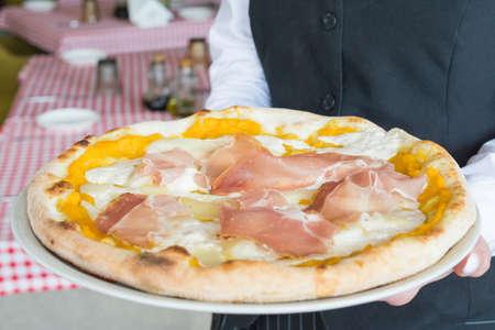 Delicious pizza Parma according to an Italian recipe