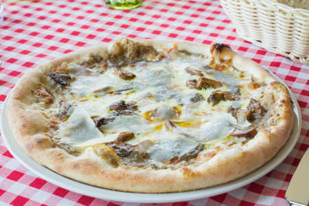 Delicious Italian mushroom pizza with truffle cheese, parmesan cheese, mozzarella cheese