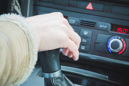 Close up of hand of female driver shifting gear