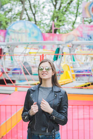 Portrait of an attractive girl in an amusement park