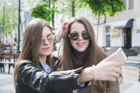 friendship concept two girls taking selfie in the city