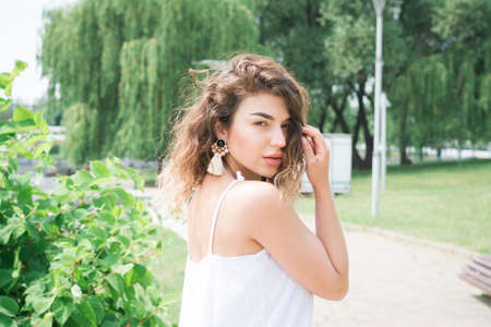 beautiful young girl in the summer park