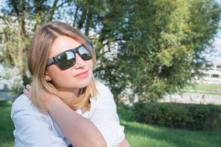 portrait of a beautiful pensive woman in sunglasses, lifestyle concept