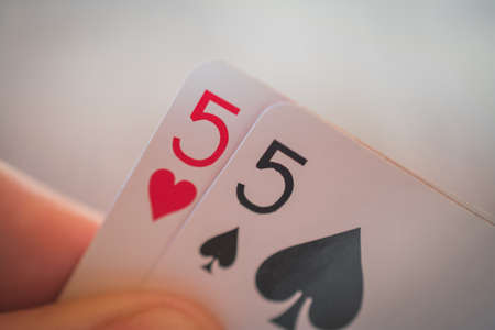 Double five, Playing cards in hand on the table, poker nands, game concept