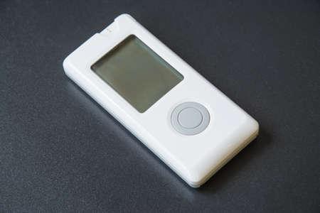 Blood sugar meter for diabetics close-up on black background