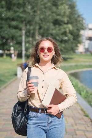 University student walks through campus to class