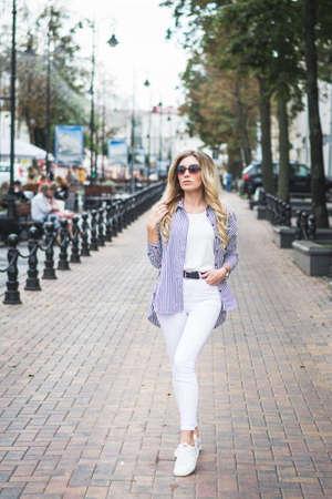 Fashion portrait stylish urban girl posing old city street